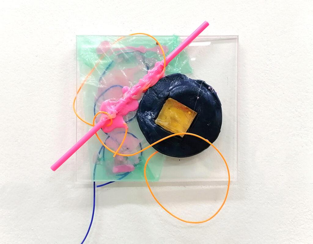 Visual-pollution,-plastic-fragment-on-plexiglass,-30x30-cm
